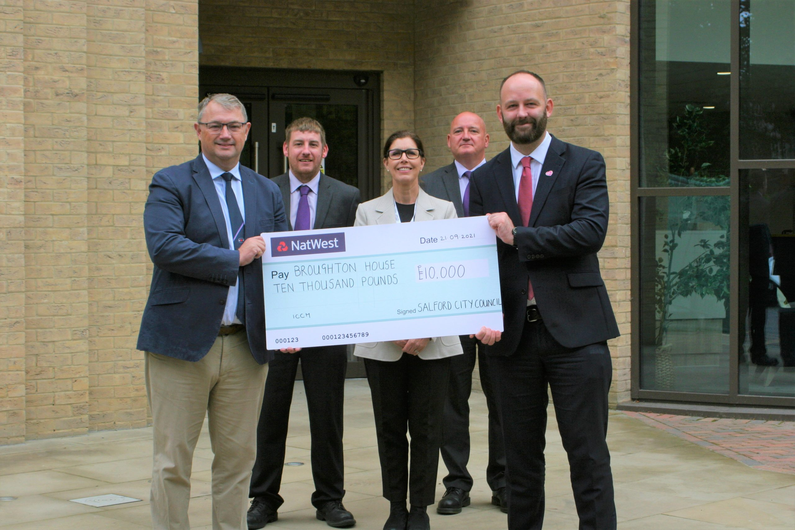 Salford Mayor Paul Dennett gives £10,000 cheque to Broughton House